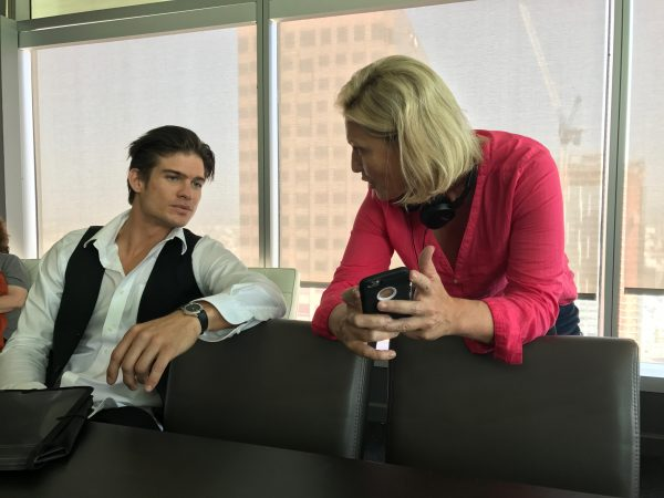 Director Tosca Musk discusses upcoming shots with actor Tyler Johnson on the set of Afterburn Aftershock.